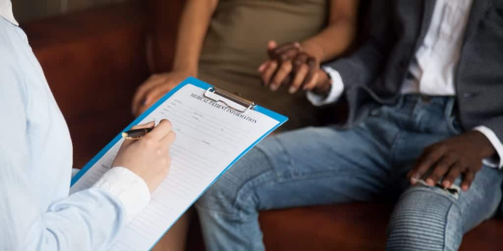Couple getting counseling together seeing therapist